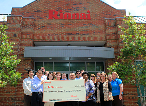 Rinnai America Corporation presents ALS Association employee Anita Flowers with donation at RAC headquarters in Peachtree City, Georgia.